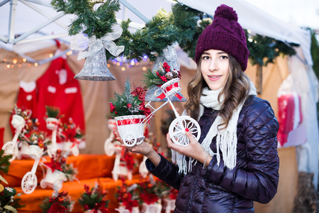 overspending: Portrait of  young european female   customer near counter with Christmas gifts Stock Photo