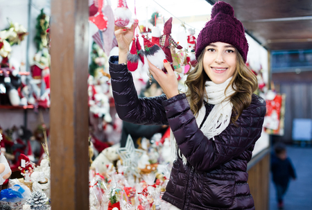 overspending: Portrait of  young female   customer near counter with Christmas gifts Stock Photo