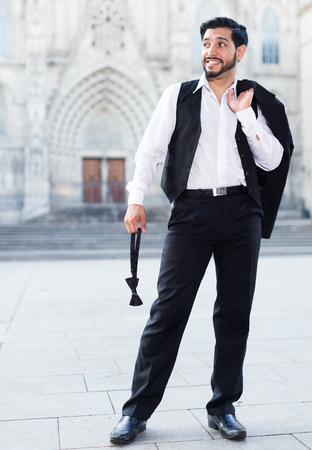 seducer: Full-length portrait of handsome man standing at ancient street Stock Photo