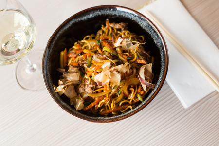 Nicely served japanise style meal yakisoba with veal and vegetables