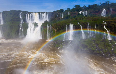 noteworthy: Rainbow over streams of waterfall Cataratas del Iguazu in Iguazu National Park, Brazil