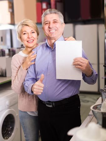 rescheduling: Husband and wife are buying in store on credit household appliances for their home. Stock Photo