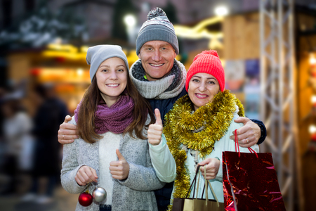Positive portrait ordinary parents with teen girl in market Stock Photo