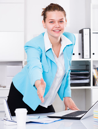 expertize: Businesswoman is going to meet first visitors in her office.