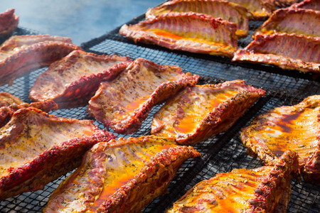 Meat ribs of pig roasting on barbecue grill for summer picnic