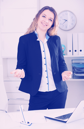 positiv: Cheerful and young  businesswoman in shirt working in the office