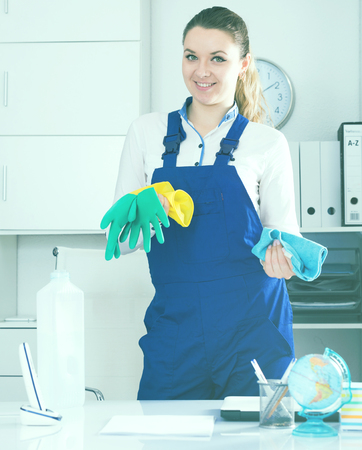 positiv: Portrait of young girl cleaning the room with mop Stock Photo