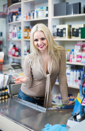 Portrait of positive european store clerk at household and cosmetic shop Stock Photo