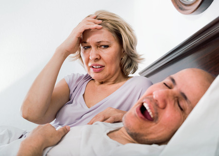 Mature  evil woman disturbed with partner snores continiously