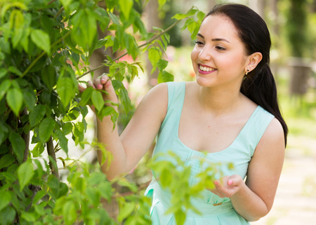 spring positive smiling young germany female portrait in green garden Stock Photo