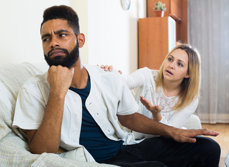 Upset black man and frustrated white housewife having bad quarrel