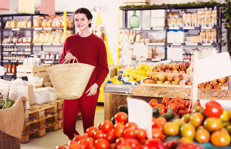 Portrait of happy young american customer selecting fruits in grocery Stock Photo