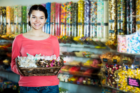 shop window: Photo of  girl in the shop window with lots of sweets Stock Photo