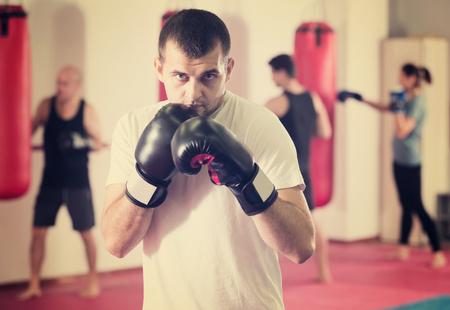 Portrait of sportsman  training in  boxing gloves