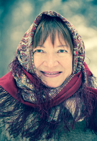 Outdoor wintry portrait of mature woman in babushka Stock Photo