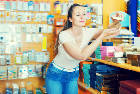 pasteboard: Pretty girl with gift boxes in her hands in store Stock Photo