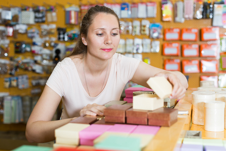 Female emptor reviews gift boxes in the store Stock Photo