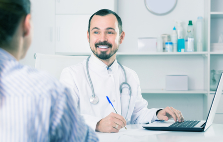 Man doctor consultation client in hospital