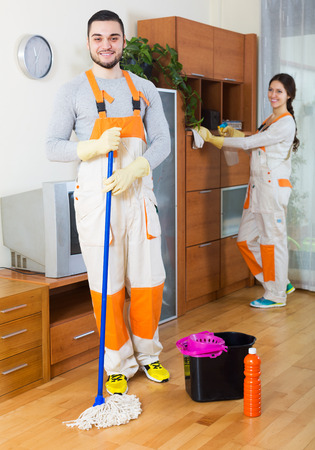Cleaning premises team is ready to work in room