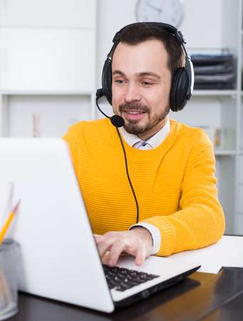 Male student having a productive day at online courses at home Stock Photo