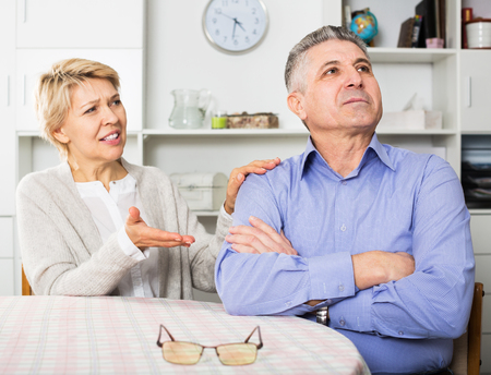 Mature couple quarrels with each other at clarification of the family relation