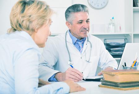 Professor of medicine advising his colleague in preparation of scientific medical research Stock Photo