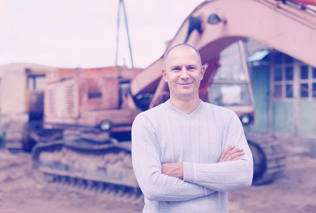 Portrait of tractor operator at workplace