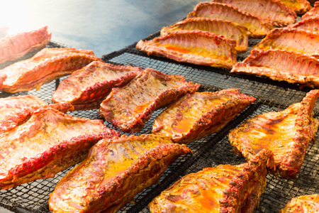 Image of tasty pork ribs preparing on grill brazier outdoors Stock Photo