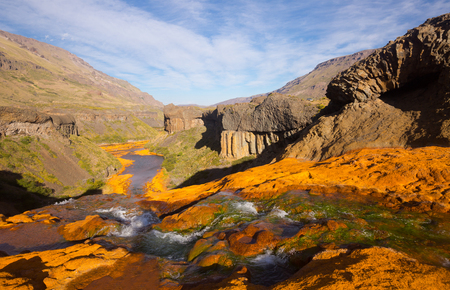 ochre: Spectacular view on Agrio River valley and Salto del Agrio in Argentina Stock Photo