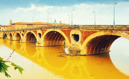Pont Neuf is staying over the Garonne river in Toulouse in France.