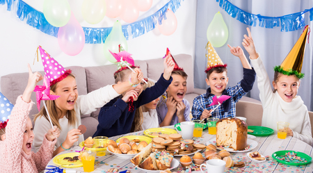 active children having good time during friend's birthday party Stock Photo