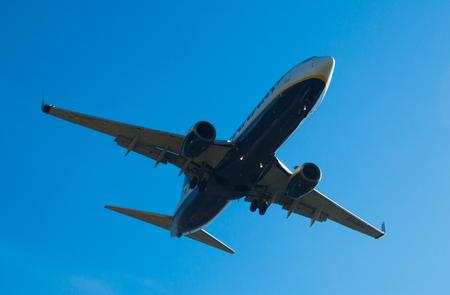 BARCELONA, SPAIN - MARCH 09, 2017:  Ryanair Airlines plane landing in El Prat Airport on time. Barcelona, Spain