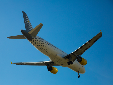 BARCELONA, SPAIN - MARCH 09, 2017:  Vueling Airlines plane arriving at El Prat Airport on schedule. Barcelona, Catalonia Editorial