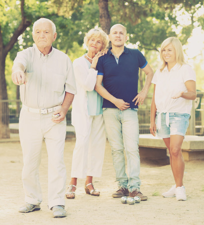 Happy elderly people playing bocce in the garden Stock Photo