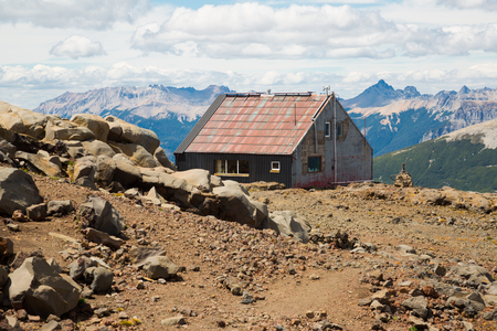 Small tourist shelter (refugio) of several houses on mountain Tronador and glaciers. Patagonia, Argentina