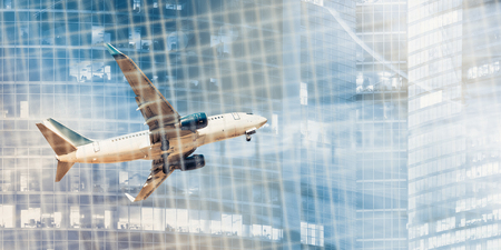 White plane flying on background of blurred skyscrapers and binary key Stock fotó
