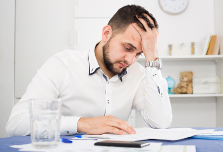 Distressed man having difficulties with paying utility bills and rent
