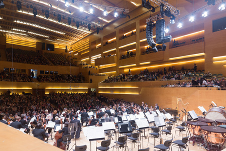BARCELONA, SPAIN - NOVEMBER 28, 2015: Music hall Auditori.  Audience and orchestra municipal de Barcelona at the concert Romeo and Juliet by Prokofiev Editorial