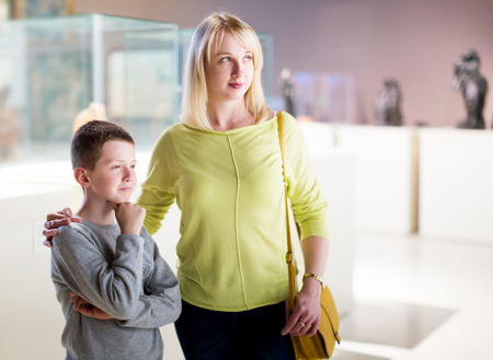 Young mother and son exploring expositions in museum Stock Photo