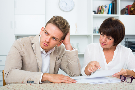 Attentive man consults at the familiar lawyer concerning paperwork