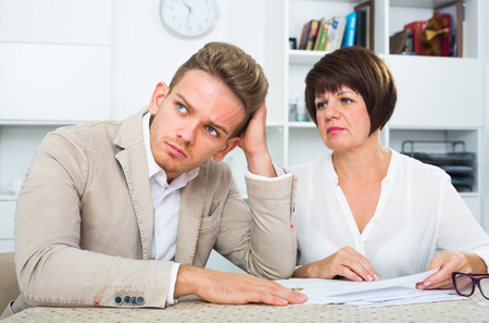 Man consults at the familiar friendly lawyer concerning paperwork