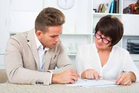Man consults at the familiar mature lawyer concerning paperwork Stock Photo