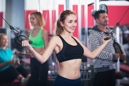 Active Happy smiling people  weightlifting training in modern health club