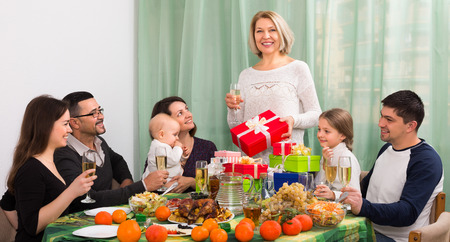 granny and grandad: grandmother celebrating jubilee with big family at festive table