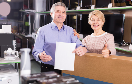 rescheduling: Mature married couple are happy buying on credit household appliances for home Stock Photo