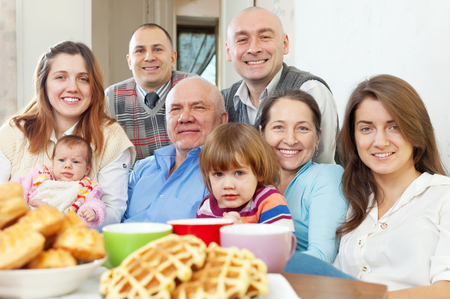 happy family posing together over tea at home Stock Photo