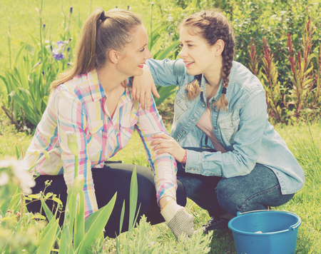 positive two young germany females working in the outdoor
