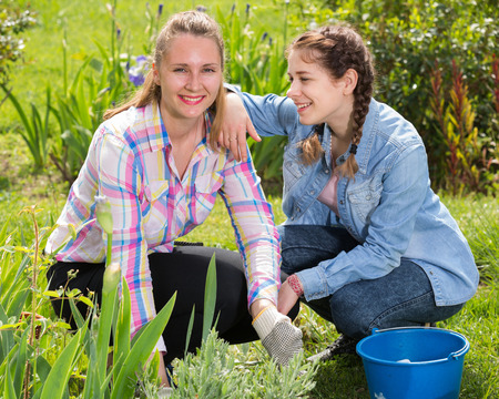 smiling two young american  females working in the outdoor Stock Photo