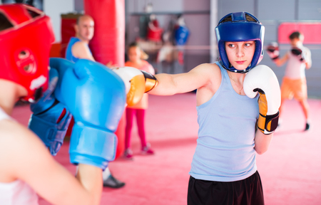 Teenagers prepare for boxing competitions in the gym