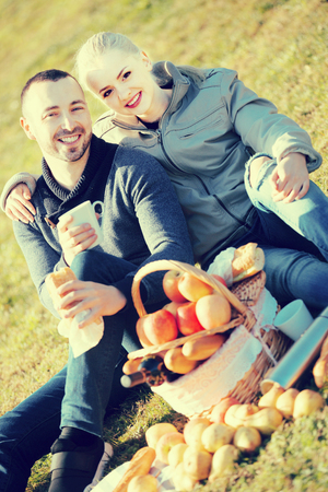 sandwitch: Portrait of  adult couple with apples and sandwitches in nature